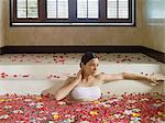 Young woman bathing Stock Photo - Premium Royalty-Free, Artist: Cultura RM, Code: 6114-06590075