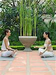 Two women meditating Stock Photo - Premium Royalty-Free, Artist: Blend Images, Code: 6114-06590088