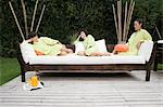 Women relaxing in spa garden Stock Photo - Premium Royalty-Free, Artist: Blend Images, Code: 6114-06590103