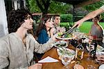 Friends having a meal Stock Photo - Premium Royalty-Free, Artist: Blend Images, Code: 6114-06590117