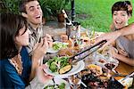 Friends having a meal Stock Photo - Premium Royalty-Free, Artist: Cultura RM, Code: 6114-06590119