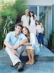Family outside their house Stock Photo - Premium Royalty-Free, Artist: Westend61, Code: 6114-06590208