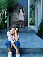 sad child sitting - Girl looking sullen Stock Photo - Premium Royalty-Freenull, Code: 6114-06590232