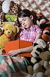 Sleeping girl with book and toys Stock Photo - Premium Royalty-Free, Artist: Westend61, Code: 6114-06590235