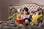 Girl with book and toys Stock Photo - Premium Royalty-Free, Artist: Blend Images, Code: 6114-06590241