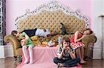 Children at tea party Stock Photo - Premium Royalty-Free, Artist: Westend61, Code: 6114-06590257