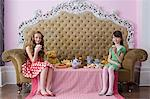 Girls having a tea party Stock Photo - Premium Royalty-Free, Artist: Blend Images, Code: 6114-06590264