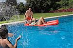 Family having fun in swimming pool Stock Photo - Premium Royalty-Free, Artist: Blend Images, Code: 6114-06590409