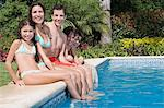 Family by swimming pool Stock Photo - Premium Royalty-Free, Artist: CulturaRM, Code: 6114-06590417
