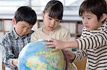 Children looking at a globe Stock Photo - Premium Royalty-Free, Artist: Raimund Linke, Code: 6114-06590431