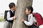 Boy and a girl next to a tree Stock Photo - Premium Royalty-Free, Artist: Blend Images, Code: 6114-06590433