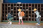 Children getting her shoes Stock Photo - Premium Royalty-Free, Artist: Blend Images, Code: 6114-06590440