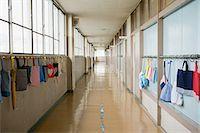 Bags hanging in a corridor Stock Photo - Premium Royalty-Freenull, Code: 6114-06590458