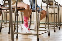 Children sat at desks Stock Photo - Premium Royalty-Freenull, Code: 6114-06590475