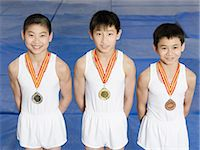 Young gymnasts with medals Stock Photo - Premium Royalty-Freenull, Code: 6114-06590488