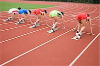 race track (people) - Athletes on starting line Stock Photo - Premium Royalty-Freenull, Code: 6114-06590497
