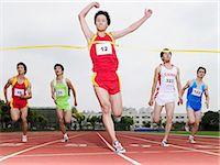 runner (male) - Winning the race Stock Photo - Premium Royalty-Freenull, Code: 6114-06590498