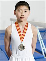 Boy wearing a medal Stock Photo - Premium Royalty-Freenull, Code: 6114-06590505