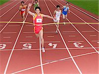 finish line - Winning the race Stock Photo - Premium Royalty-Freenull, Code: 6114-06590506