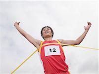 finish line - Runner winning race Stock Photo - Premium Royalty-Freenull, Code: 6114-06590508