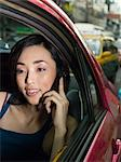Woman on cellphone in taxi Stock Photo - Premium Royalty-Free, Artist: Robert Harding Images, Code: 6114-06590513