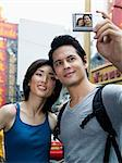 Couple taking a photograph Stock Photo - Premium Royalty-Free, Artist: Christina Krutz, Code: 6114-06590515