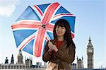 Young woman with union jack umbrella Stock Photo - Premium Royalty-Freenull, Code: 6114-06590516