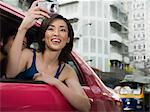 Woman taking pictures from taxi Stock Photo - Premium Royalty-Free, Artist: Martin Frster, Code: 6114-06590517
