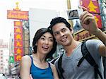 Couple taking a photograph Stock Photo - Premium Royalty-Free, Artist: Cultura RM, Code: 6114-06590520