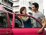 Couple getting into taxi Stock Photo - Premium Royalty-Free, Artist: CulturaRM, Code: 6114-06590523
