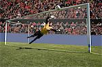 Goalkeeper making a save Stock Photo - Premium Royalty-Free, Artist: Blend Images, Code: 6114-06590525