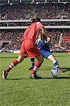 Opposite player tackling footballer Stock Photo - Premium Royalty-Free, Artist: Cultura RM, Code: 6114-06590534