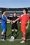Opposite football player shaking hands Stock Photo - Premium Royalty-Freenull, Code: 6114-06590539