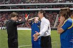 Footballer and football manager arguing with referee Stock Photo - Premium Royalty-Freenull, Code: 6114-06590543