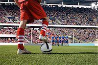 footballeur - Footballer about to take a free kick Stock Photo - Premium Royalty-Freenull, Code: 6114-06590545