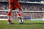 Footballer about to take a free kick Stock Photo - Premium Royalty-Free, Artist: Ikon Images, Code: 6114-06590545