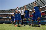 Football manager and footballers celebrating Stock Photo - Premium Royalty-Free, Artist: ableimages, Code: 6114-06590546