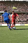 Opposite player tackling footballer Stock Photo - Premium Royalty-Free, Artist: Blend Images, Code: 6114-06590552
