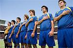 Footballers in a row Stock Photo - Premium Royalty-Free, Artist: Westend61, Code: 6114-06590554