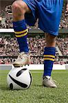 Footballer with his foot on a football Stock Photo - Premium Royalty-Free, Artist: urbanlip.com, Code: 6114-06590557