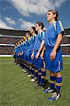 Footballers in a row Stock Photo - Premium Royalty-Free, Artist: Blend Images, Code: 6114-06590562