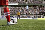 Footballer about to take a penalty Stock Photo - Premium Royalty-Free, Artist: Westend61, Code: 6114-06590563