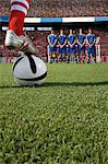 Footballer about to take a free kick Stock Photo - Premium Royalty-Free, Artist: Blend Images, Code: 6114-06590567