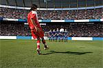 Footballer taking a free kick Stock Photo - Premium Royalty-Free, Artist: Minden Pictures, Code: 6114-06590569