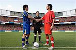 Opposite football player shaking hands Stock Photo - Premium Royalty-Freenull, Code: 6114-06590570