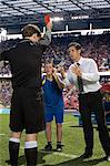 Footballer and football manager arguing with referee Stock Photo - Premium Royalty-Freenull, Code: 6114-06590573