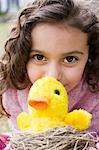 Girl with a toy chick Stock Photo - Premium Royalty-Free, Artist: Westend61, Code: 6114-06590601