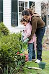 Mother and daughter watering plants Stock Photo - Premium Royalty-Free, Artist: Aflo Relax, Code: 6114-06590624