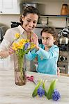 Woman and daughter with flowers Stock Photo - Premium Royalty-Free, Artist: Robert Harding Images, Code: 6114-06590627