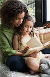 Mother and daughter reading Stock Photo - Premium Royalty-Free, Artist: ableimages, Code: 6114-06590639